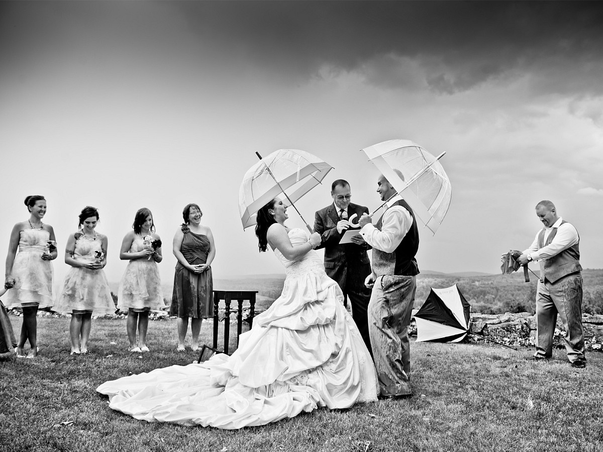 Weddings-Rain-Ceremony-Umbrellas-Outdoor-Downpour.jpg